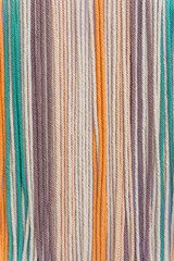 Colorful macrame threads texture closeup