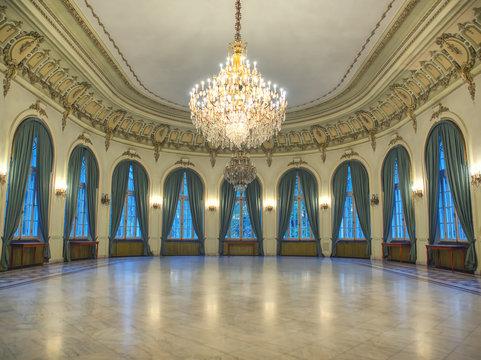 Sinaia, Romania - October 30, 2019: Big castle dancind room with candelabra in th middle. Castle interior. Empty room