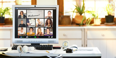 A computer screen in a home office showing a group of people waiting to start a video conference