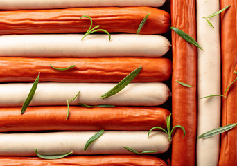 Wall Mural - Close-up of sausages sprinkled with rosemary.