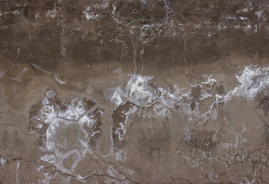 smudges, cracks and white mold on a concrete wall