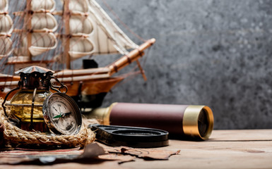 Columbus Day. Pirates and treasure with vintage worldmap and discovery of old equipment. Copy space on dark background.