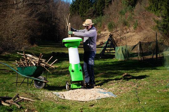 Garden shredder or wood chipper for shredding tree or shrub cuttings.
