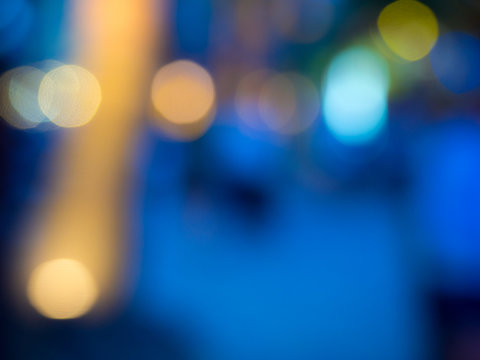 Blurred reflections of colored lights.