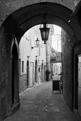 Wall Mural - Old street with archway in San Marino