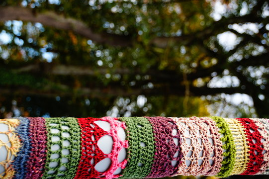 Low Angle View Of Colorful Yarn Bombing On Pole