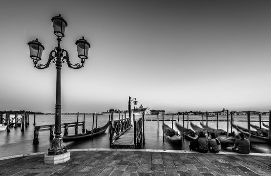 Venice, Italy - Lamp post in the city of love. Illuminating the local streets and boat stops, by the marina and show gondoliere the way home