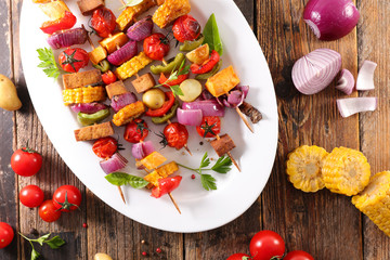 Wall Mural - vegetable grilled barbecue with cob corn, tomato,bell pepper,onion