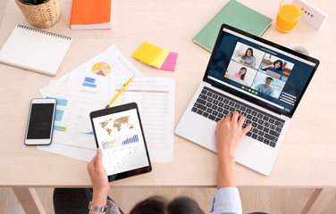asian woman work from home with video conference app collaboration with colleagues with business...