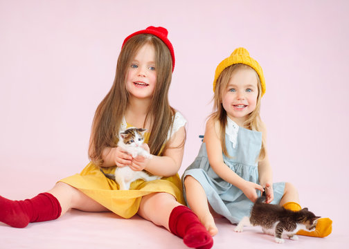portrait of two girls sisters in the studio