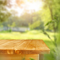 Fototapete - Desk of free space and blurred spring garden