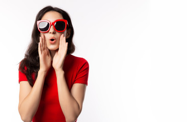 Portrait excited beautiful woman wearing retro red sunglasses. Surprised young female look telling something. She get happy, announce that product on sale, discount in summer time. isolated on white