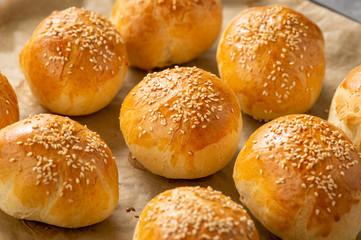 Fototapeta Homemade fresh bread buns with sesame seeds. obraz