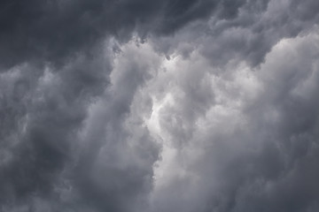 Light in the Dark and Dramatic Storm Clouds. dark storm clouds before rain. Background image in a dark gray style.