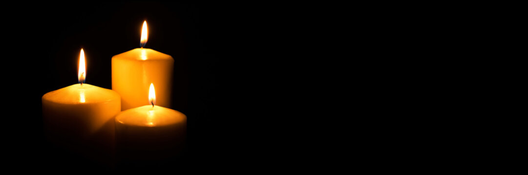 Flame candles isolated on black background. Close up.