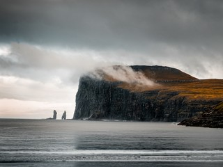 Shot capturing the beautiful nature of the Faroe Islands, sea, mountains, cliffs Wall mural
