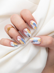 Aluminium Prints Manicure Woman's hand with fashionable nails holding fabric
