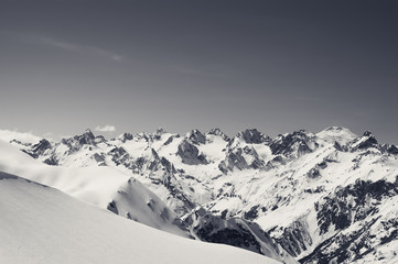 Fototapete - Snow covered mountains and snowy off-piste slope for freeriding