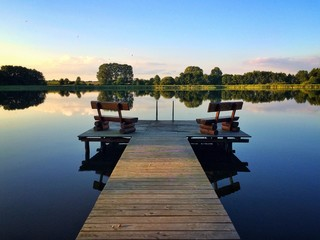 Jetty With Benches On A Lake