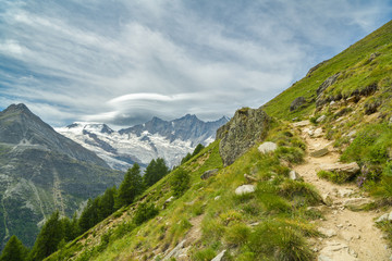 Wall Mural - Walking trail from Kreuzboden to Saas-Almagell with incredible views on always white Alps above the Saas-Fee village in Switzerland