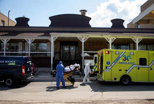 Ambulance attendants transport a resident from seniors' long-term care centre in Montreal