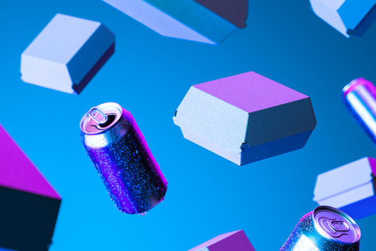 Blank Box From Recyclable Craft Paper Or Cardboard Near Aluminium Cans With Cold Droplets Illuminated by Neon Light. 3d rendering