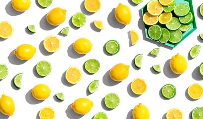Fresh lemons and limes overhead view - flat lay