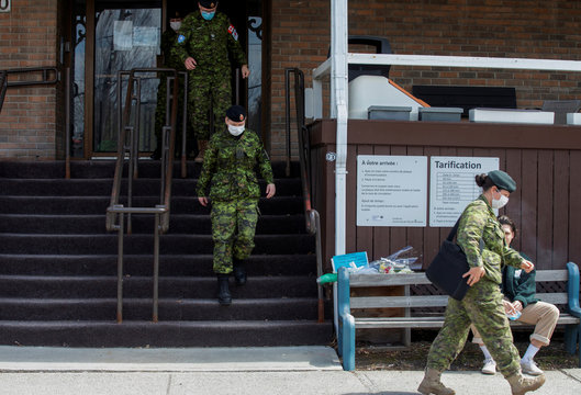 Canadian Armed Forces medical personnel leave after  they came to assess and liason at seniors' long-term care centre in Montreal