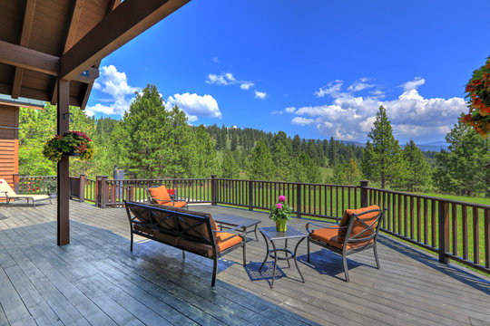 Amazing beautiful mountain home in Cascade Mountains in USA with green lavish nature and  cedar large home with back porch.