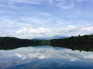 Fototapeta Reflection Of Clouds In Calm Lake