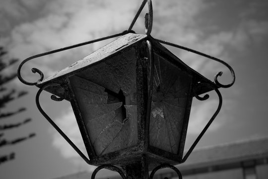 Low Angle View Of Broken Street Light Against Sky