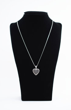 A sterling silver necklace with a beautiful heart shaped pendant