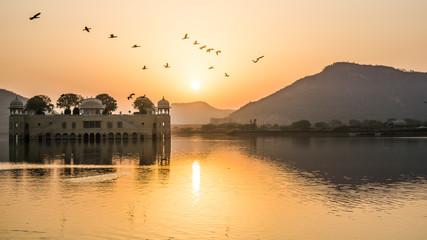 Fototapeta Birds Flying Over Lake Against Sky During Sunset