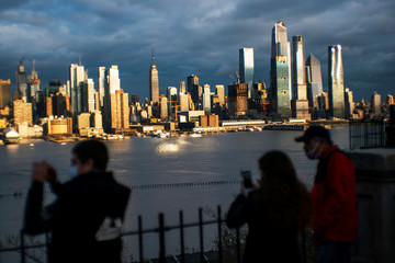 People take a look at the New York City skyline during the outbreak of the coronavirus disease (COVID-19) in New York City, as seen from Weehawken
