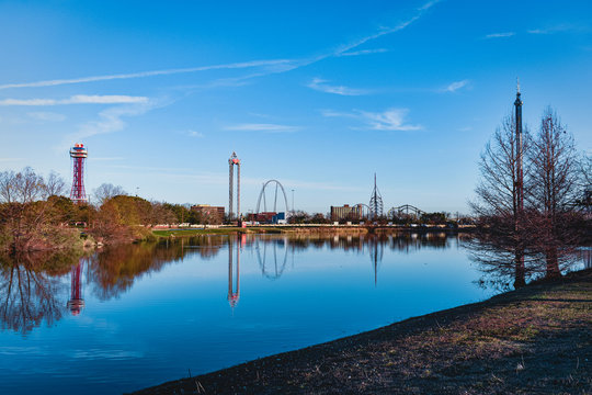 Six Flags over Texas reflecting off a lake