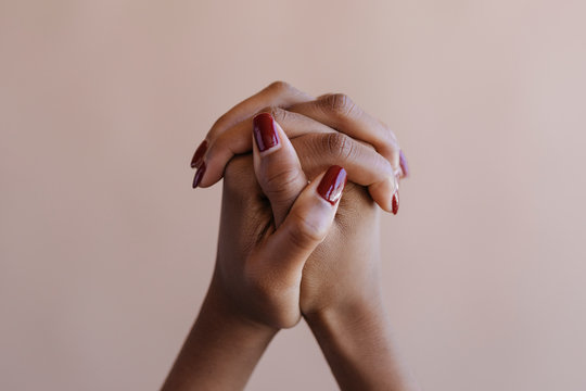 Tanned manicured female hands