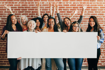 Happy women holding empty banner