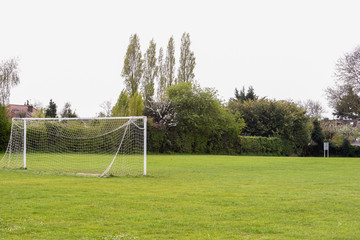 Empty football pitch in public park with no people
