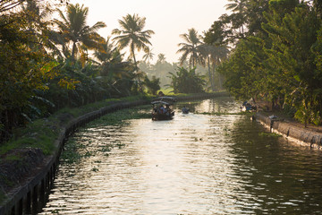 Alleppey, Kerala - January 6, 2019: boats in a canal in alleppey backwaters kerala india