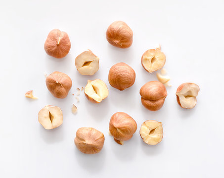 Full and half of hazelnuts on white background top view. Isolated
