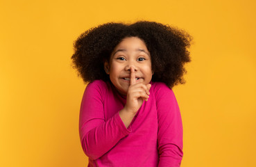 Keep Silence. Little Black Girl Showing Shh Sign On Yellow Background