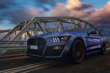 Ford Mustang Shelby GT500 riding on a steel bridge