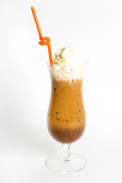 iced coffee top with whipped cream in a tall glass isolated white background