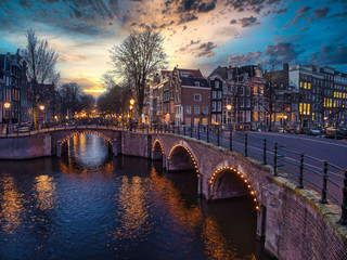 Fototapete - Typical Amsterdam Bridge View, under an amazing Sky at Sundown