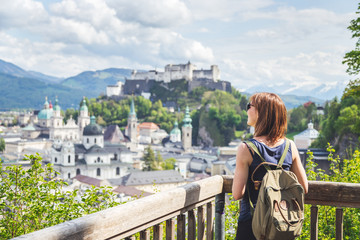 Holiday in Salzburg: Young girl is enjoying the view. Historic district, Festung Hohensalzburg Fototapete