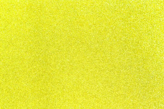 Yellow glitter shiny texture background for christmas, Celebration concept.
