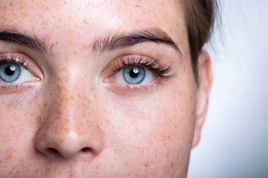 A close up of a person with blue eyes looking at the camera