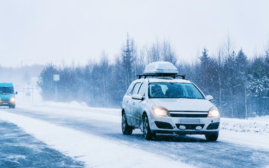 Wall Murals Road in forest Car with roof rack and winter snowy road at Rovaniemi reflex
