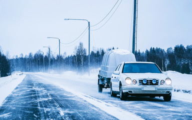 Wall Murals Road in forest Car with trailer and winter snowy road at Rovaniemi reflex