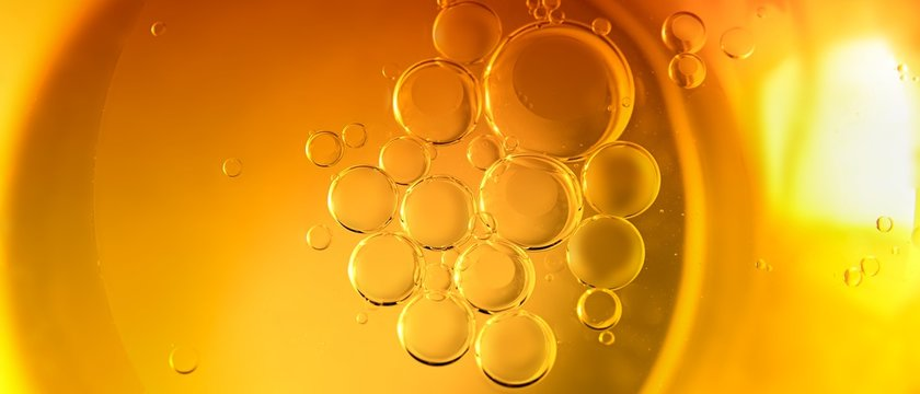 Cooking oil, cooking background, yellow oil drops and water kitchen.